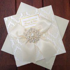 Pearl Brooch Embellished Flocked Wedding by RoyalStyleWeddings