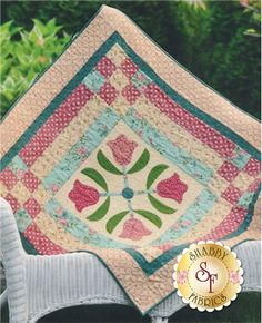 """Tulip Topper Pattern: Decorate your table with this applique table topper designed exclusively by Shabby Fabrics. Tulip Topper brings a soft and elegant feel to your home and finishes at 47 1/2"""" x 47 1/2"""". This table topper was made with Rambling Rose yardage by Moda Fabrics."""