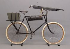 Columbia Model 40 military bicycle with Colt Model 1895 machine gun, late 19th century.  from the Buffalo Pedling History Museum