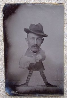 Tintype studio photo taken with comical painted board in front of the sitter