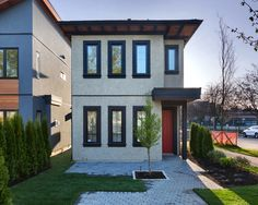 Bright white space! Open style living with clean, modern lines are the shining star of this Kerrisdale Classic home. The exterior of the home features contemporary pieces, including the black trim windows and a pop of colour with the bright red door!