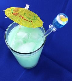 Blue Hawaiian   •1 ounce Blue Curacao   •1 ounce white rum   •3 ounces pineapple juice   •1 ounce sweetened coconut cream