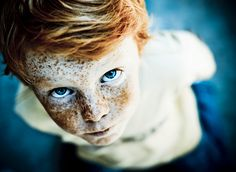 Little boy with red hair, blue eyes, freckles
