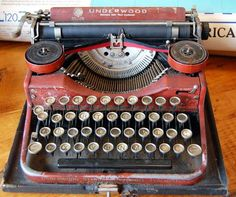 1926 Underwood portable typewriter with a red faux bois (fake wood grain) finish.