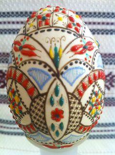 Hand painted and waxed Romania Pysanka egg.