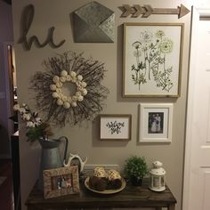 Entryway gallery wall with a rustic farmhouse theme, most pieces found @ Hobby Lobby