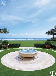 A fountain on the estate echoes the blue of the Atlantic Ocean beyond | archdigest.com