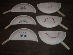 The BCW Lady says: Moody Masks  All you need is paper plates and markers.  The popsicle sticks can be left off if you don't have them.  Good social emotional play
