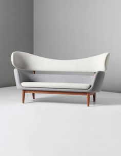 FINN JUHL, Baker sofa, circa 1951. Wool fabric and teak. Produced by Baker Furniture, Inc., USA. / Phillips
