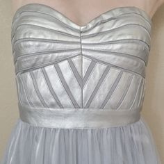 👗HP👗Aidan Mattox Silver Prom Dress NWT 4/23 Best in Prom Host Pick. Reposh! Size 8 tulle Aidan Mattox gown with tags still attached. Structured metallic baroque style top can be worn with or without straps. And it has pockets!!! I bought this for prom but decided it wasn't really my style after all, so I'm reselling it to a lucky Posher! Aidan Mattox Dresses Prom