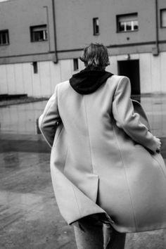Lucas wears sweatshirt Sergio Tacchini, coat and pants Ermenegildo Zegna Couture.
