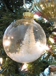 "bottle brush tree in clear glass ornament - from ""25 ways to decorate clear glass ornaments"""