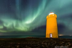 """Holmsberg Lighthouse and Northern Lights."" by Kjartan Guðmundur Júlíusson, via 500px."