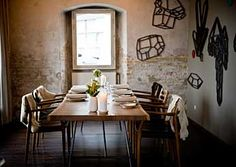 Noma restaurant Copenhagen  new take on Nordic cuisine  brick/stone wall, wood floors, danish style chairs, geometric wall art