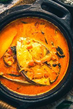 Alleppey Fish Curry is a Kerala Style spicy Fish Curry which is slightly tangy due to the use of raw mangoes or Tamarind. Here is a step by step recipe to make it in a traditional way. Fish Dishes, Seafood Dishes, Seafood Recipes, Cooking Recipes, Prawn Recipes, Indian Fish Recipes, Ethnic Recipes, Kerala Recipes, Indian Foods