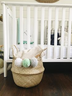 Touches of mint in this gray nursery give it such a fresh look for a baby girl or baby boy.