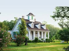 Charming small home !  Great proportions. Love the size of the shutters. The trellis columns. The Cupola. The Dormered Windows .on and on and on !