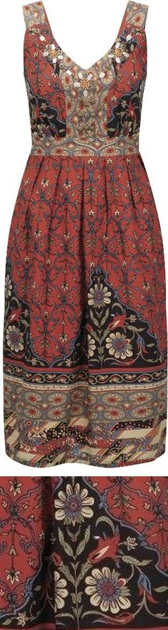 Cute plus-size folk-inspired printed dress for fall 2014 - with closeup of floral pattern - http://www.boomerinas.com/2014/10/12/folk-fashion-trend-in-plus-sizes-2014-vintage-styles-for-modern-women/
