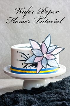 Learn how to decorate cakes with wafer paper in the shape of a flower. Wafer paper decorations are a festive addition to a wide variety of cakes! CakeJournal.com