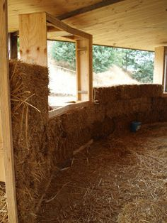 Building the round strawbale house: And they huffed and they puffed...