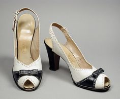 Pair of Woman's Pumps  I. Magnin & Co. (United States, California, Los Angeles, founded 1893)  I. Miller (United States, 20th century)  United States, circa 1942  Costumes; Accessories  Leather, suede, metal  10 1/2 x 3 1/4 x 5 1/2 in. (26.67 x 8.25 x 13.97 cm) each; Size: 7 1/2 AA  Gift of Mrs. Katherine Bryant (M.81.218.23a-b)  Costume and Textiles