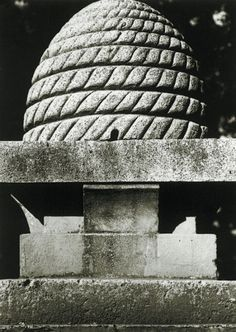 """Brigham Young Lower Campus Beehive Monument. The beehive emblem is in the form of an old-style beehive known as a """"skep"""". These dome-shaped skeps were made using twisted coils of straw. Mormon pioneers brought five of them to Utah in 1848."""
