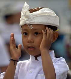 hindu boy in ceremony day clothes.. the rice on his forehead means he has cleansed his mind