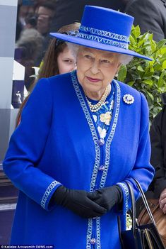 The Queen accessorised with an Angella Kelly hat and black gloves...