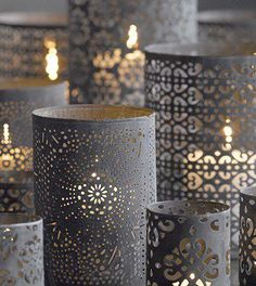 How to Make Moroccan Cylinder Lights :: prepunched paper [Michael's] + glass cylinder • wrap cylinder with paper cut to fit & affix with rubber cement