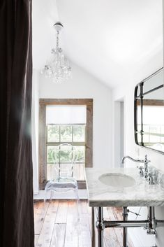 A bright spa-like bathroom is on the second floor.