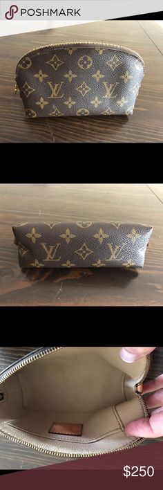 Louis Vuitton Cosmetic Pouch Authentic LV cosmetic pouch, exterior in excellent condition aside from marking on small leather tab (shown).  Interior has some marks (shown). Louis Vuitton Bags Cosmetic Bags & Cases