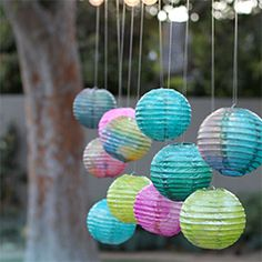 Watercolor Paper Lanterns - A craft simple enough for kids to make, with results sophisticated enough for a backyard dinner party.