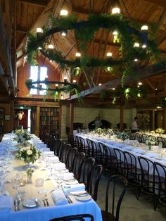 The amazing Bendooley Bookbarn in the Southern Highlands. A gorgeous foliage hanging installation on the chandeliers, bentwood chairs, long tables and beautiful David Austin roses in crystal vases ~ heaven!