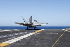 "An F/A-18F Super Hornet, assigned to the ""Jolly Rogers"" of Strike Fighter Squadron (VFA) 103, launches from the flight deck of aircraft carrier USS Harry S. Truman (CVN 75)."