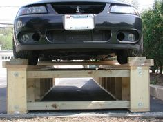 Check out this home made all wood car lift the garage for Garage auto fab ennery