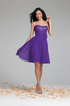 This floor length dress features a strapless neckline in chiffon over silver sequins and optional spaghetti straps.