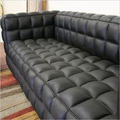 Black leather tufted sofa