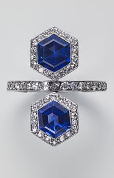 "An Art Deco platinum, sapphire and diamond Toi et Moi ring, circa 1920. The band is engraved: ""To Voilet from Neol, 21 October 1921""."
