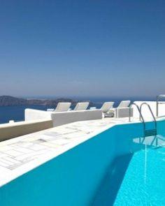 Iliovasilema Suites  ( Santorini, Greece )  The pool overlooks the caldera, though it's a little old-fashioned. #Jetsetter #JSVolcano