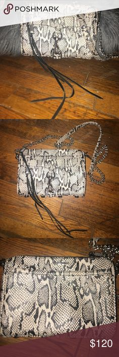 Rebecca Minkoff Handbag NWOT! This purse is perfect condition. Beautiful black and white snake skin print. Small pocket on inside, fits full size wallet. Chain link strap with the snake skin detail on top of strap. Selling to look for solid color! Rebecca Minkoff Bags