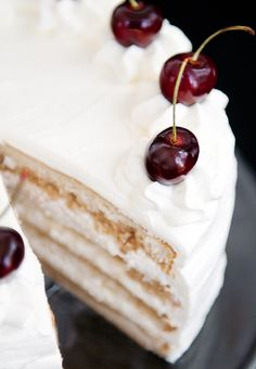 White Russian Cake...I like this whipped cream frosting stabilized with gelatin. You could probably use  flavored gelatin for extra punch.  Wonder how some pudding mix would work?