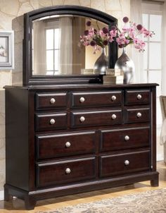 """Contemporary Dark Brown Bedroom Dresser by Famous Brand Furniture. $758.43. Made with select veneer and hardwood solids. Dovetail drawer construction. Drawers feature a satin nickel color knob and backplate. Dark brown finish. 64.06"""" W x 19"""" D x 44.5"""" H. The """"Ridgley"""" bedroom collection uses a rich finish and stylish details to create furniture that is sure to enhance any bedroom decor with an exciting contemporary design. The dark brown finish flows smoothly over the..."""