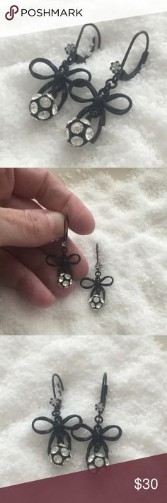 "Betsey Johnson Black Bow Earrings Betsey Johnson Earrings! Enjoy these bow earrings by Betsey Johnson featuring rhinestones and black epoxy bows. Approximate drop is 1-1/4"". Beautiful earrings with excellent ratings online. Mint condition, only worn once✨ Betsey Johnson Jewelry Earrings"