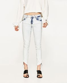 Image 2 of MID-RISE JEANS WITH RIPPED HEMS from Zara