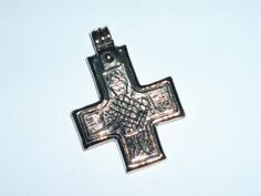 This cross is based on a find from Denmark, and is dated around 1050 AD. The period is near the end of the viking age, 793-1066 AD, and the cross marks the transition from the old beliefs in nordic mythology, to the new progressive christian religion.