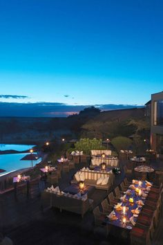 Luxury Safari Lodges in Tanzania: Dine by candlelight, but look out for grazing elephants who stop by for a drink at the resort's active watering hole. Four Seasons Safari Lodge Serengeti (Tanzania) - Jetsetter