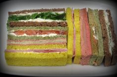 The Gourmand Girls - Rainbow Finger Sandwiches, great idea for an upmarket baby shower.  Love the yellow bread for the theme colours
