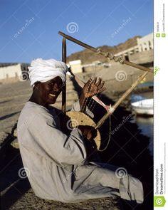 Nubian Egypt   Nubian musician in harbor of Asuan, Egypt.