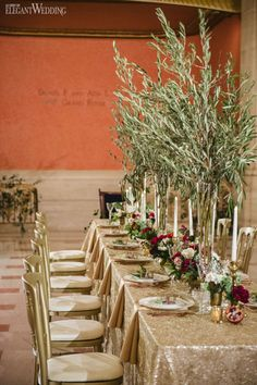 tuscany inspired wedding table setting with sequin linens and ruby red florals tuscan art