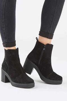 These chunky black heeled boots are a must-have this season, finished in black suede. We love with with skinny jeans rolled up at the hem. #Topshop